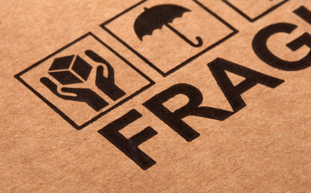 fine image close up of fragile symbol on cardboard selective focus