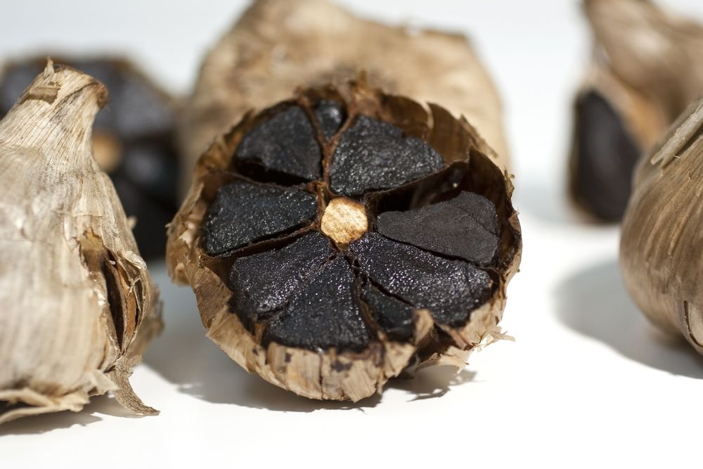 """Black garlic"" by Foodista - originally posted to Flickr as Photo of Black Garlic. Licensed under CC BY 2.0 via Commons - https://commons.wikimedia.org/wiki/File:Black_garlic.jpg#/media/File:Black_garlic.jpg"