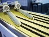 The factory conveyor, which prepares rolls with poppy